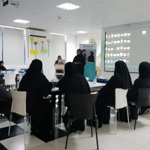 eight woman in black Arabic dresses in a conference