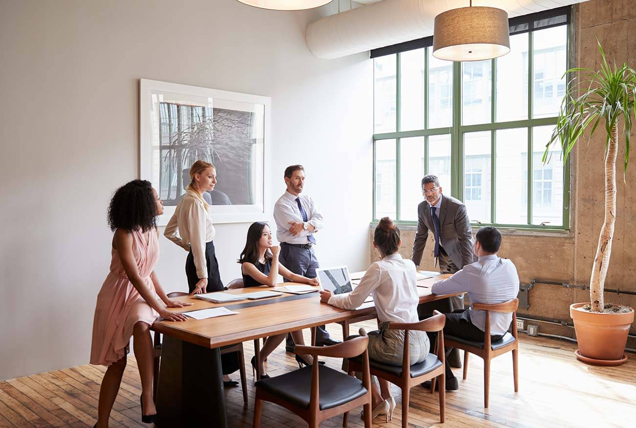 seven corporate staff in a meeting