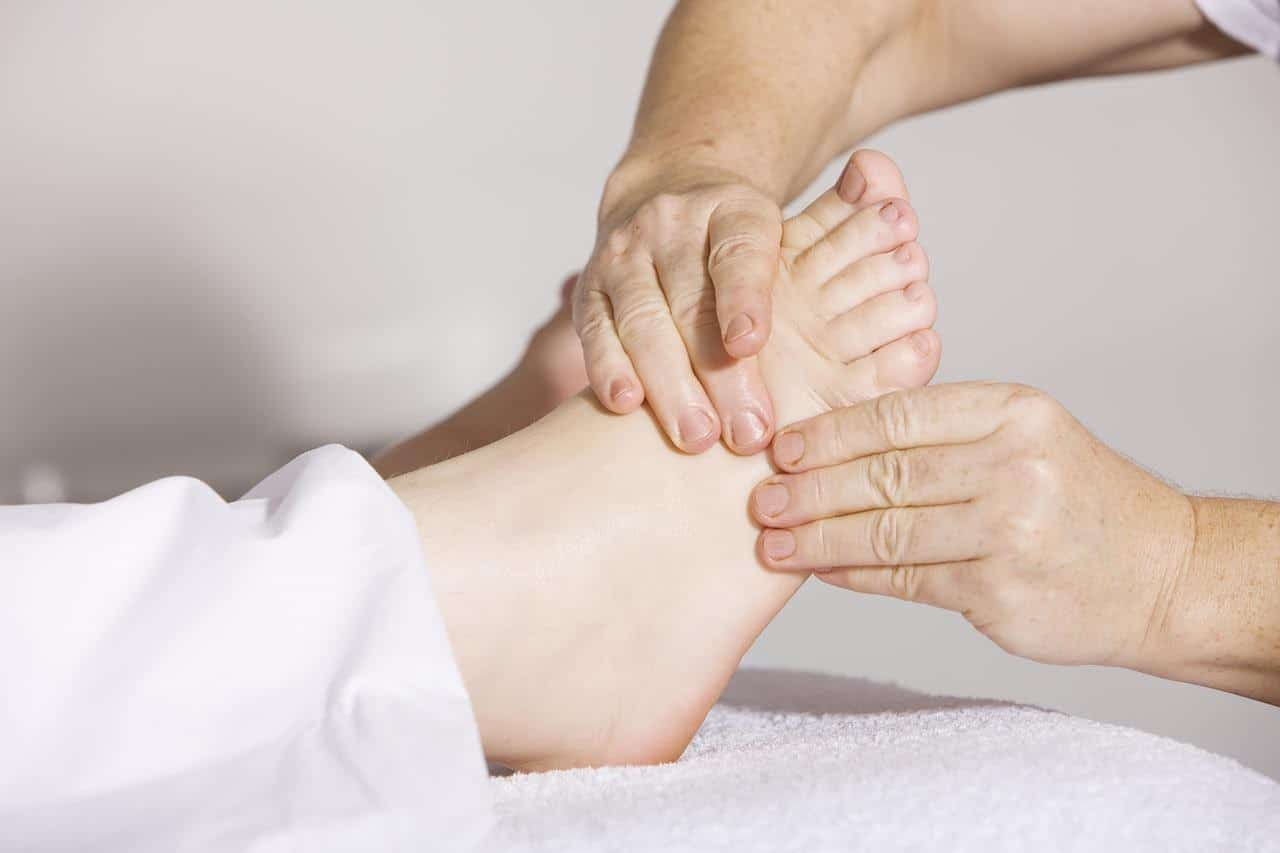 A person getting a foot massage as part of a physiotherapy session