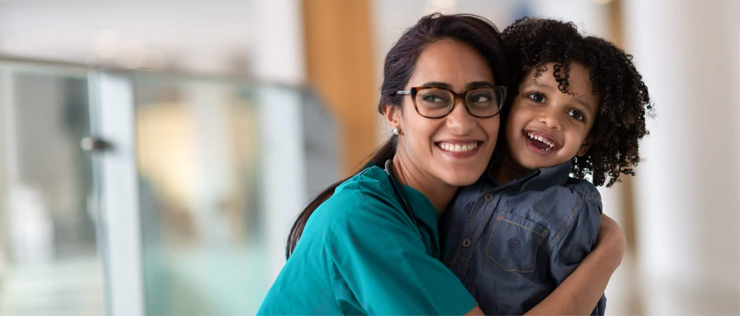 Manzil nurse hugging a child