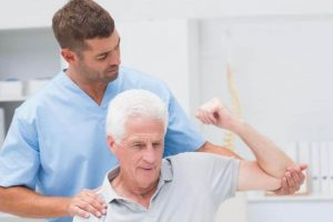 physiotherapist and elder patient